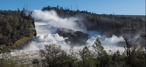 Water pours through the main spillway of the Oroville Dam on Feb. 12