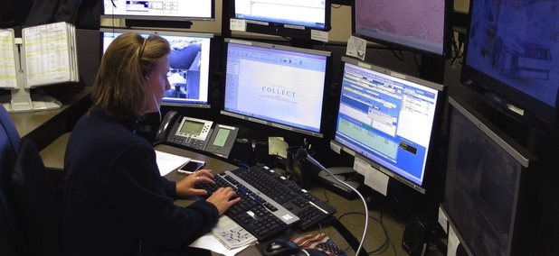 Dispatcher Kelly Orsini at her communications desk at the Naugatuck, Connecticut, Police Department.