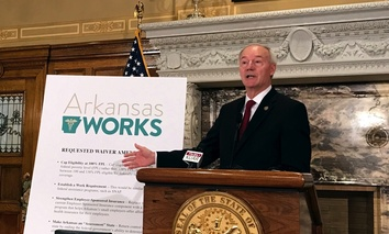 Arkansas Gov. Asa Hutchinson proposes, during a news conference on March 6 in Little Rock, adding a work requirement to the state's hybrid Medicaid expansion.