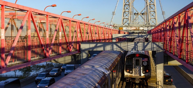 The Williamsburg Bridge in New York City carries cars, trucks and subway trains between Brooklyn and Manhattan.