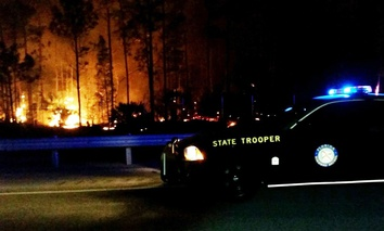 Flames burn near Interstate 75 in Collier County, Florida.