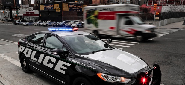 A prototype of the Ford Fusion police hybrid car sits along 11th Avenue in New York City.
