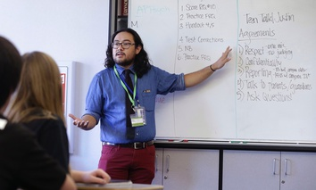 Justin Balido, peer health coordinator and senior health educator with Health Connected, speaks to a ninth-grade Teen Talk High School class at Carlmont High School in Belmont, Calif.