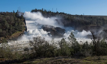 Water pours through the main spillway of the Oroville Dam in February.