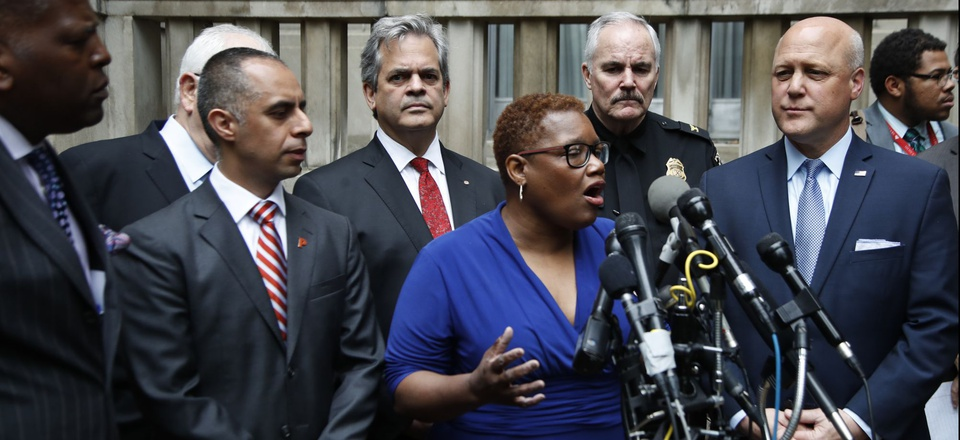Gary, Ind. Mayor Karen Freeman-Wilson and other mayors speak outside the Justice Department.