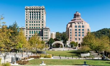 Buncombe County Courthouse (left) and the City Building (right) from Pack Square Park in Asheville, North Carolina.