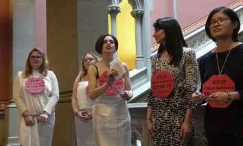 In this image taken from video, women in chains protest against child marriage, Tuesday, Feb. 14, 2017, at the Capitol in Albany, N.Y.