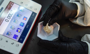 "A forensic chemist prepares a sample of the drug ""gray death"" to be weighed at the crime lab of the Georgia Bureau of Investigations in Decatur, Ga., on Thursday, May 4, 2017."