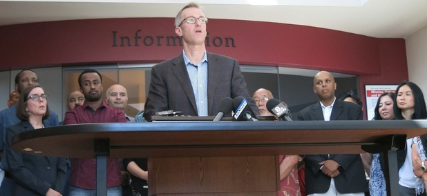 Portland Mayor Ted Wheeler speaks at a news conference after a man fatally stabbed two men Friday on a light-rail train when they tried to stop him from yelling anti-Muslim slurs at two young women, one of whom was wearing a hijab.