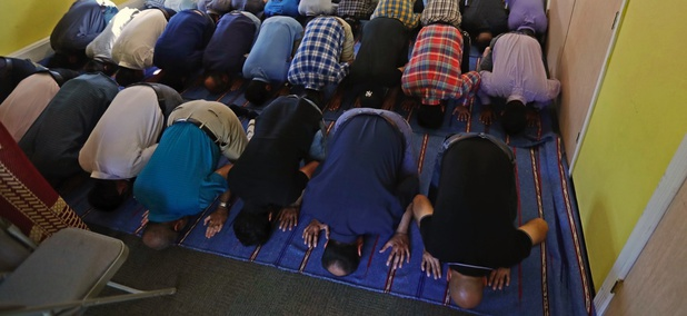 Muslim worshippers pray during a service at the Bernards Township Community Center in Basking Ridge, N.J.