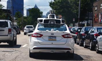 One of Uber's autonomous vehicles navigates Pittsburgh's roads.