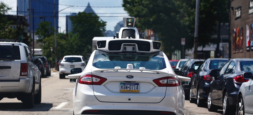 One of Uber's autonomous vehicles navigates Pittsburgh's roads.