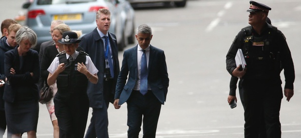 Mayor of London Sadiq Khan, center, arrives at the London Bridge area of London on Monday ahead of a vigil for victims of a presumed terrorist attack.