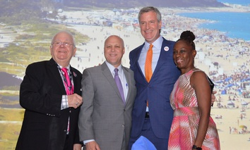 From left, USCM Executive Director Tom Cochran, New Orleans Mayor Mitch Landrieu, New York City Mayor Bill de Blasio with his wife, Chirlane McCray.