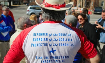 Anti-pipeline activist Allen Schreiber of Lincoln, Nebraska, wears a shirt inscribed with slogans opposing the Keystone XL pipeline during a rally outside the State Capitol.