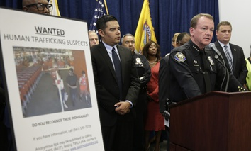 Long Beach Police Chief Jim McDonnell, right, joined by mayor Robert Garcia, center, speaks during a news conference Wednesday, Sept. 24, 2014, in Long Beach, Calif., regarding a crackdown on sex trafficking in Southern California
