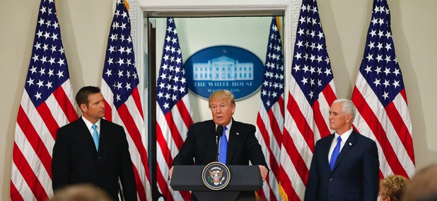 President Donald Trump, with Kansas Secretary of State Kris Kobach, left, and Vice President Mike Pence, right, speaks at a meeting of the Presidential Advisory Commission on Election Integrity on Wednesday at the White House.
