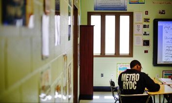 A juvenile resident sits in a classroom at the Department of Juvenile Justice's Metro Regional Youth Detention Center, in Atlanta.