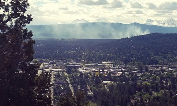 Smoke from a controlled burn rises west of Bend, Oregon
