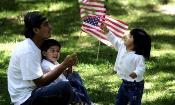 A family relaxes on the sidelines of an immigration protest outside the Capitol in Jackson, Miss. in 2006.