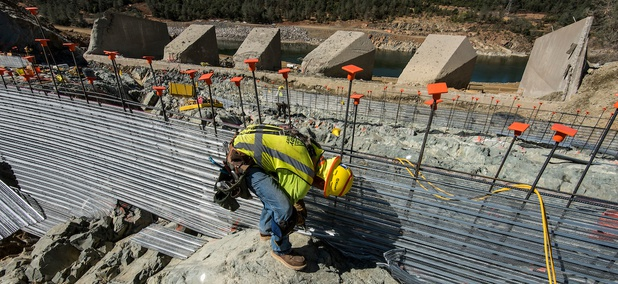Workers install stay-forms before concrete is poured on the lower chute of the Lake Oroville flood control spillway in Butte County, California, on July 12.