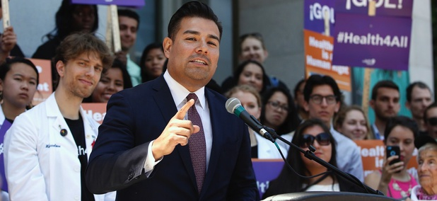California Sen. Ricardo Lara speaks at a rally where health care and immigrant rights advocates celebrated the expansion of Medi-Cal to children.