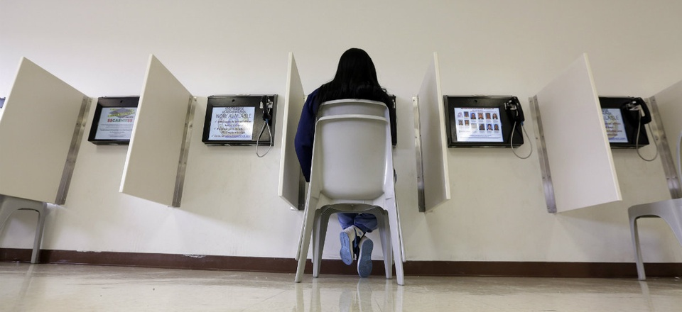 A visitor uses the video visitation system at the Fort Bend County Jail to speak with an inmate, in Richmond, Texas.