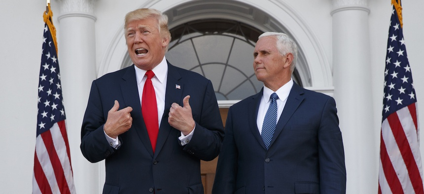 President Donald Trump, accompanied by Vice President Mike Pence, speaks to reporters at Trump National Golf Club in Bedminster, N.J.