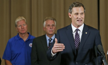 Charlottesville Mayor Mike Signer, right, gestures during a news conference concerning the white nationalist rally and violence as Virginia Gov. Terry McAuliffe, center, and Virginia Secretary of Public safety Brian Moran, left, listen.