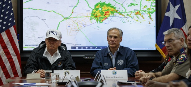 President Donald Trump, accompanied by Texas Gov. Greg Abbott, speaks during a briefing on Harvey relief efforts, Tuesday, Aug. 29, 2017, at the the Texas Department of Public Safety Emergency Operations Center in Austin, Texas.