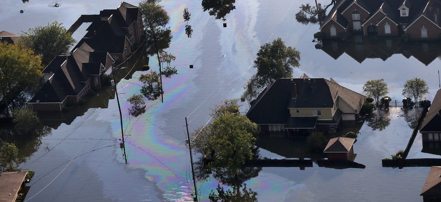 Petroleum spill off flows through floodwaters in the aftermath of Tropical Storm Harvey in Beaumont, Texas, Thursday, Aug. 31, 2017.