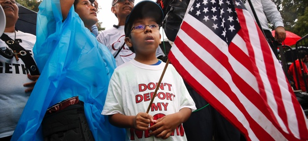 Michael Claros, 8, of Silver Spring, Maryland attends a rally for immigration reform on Aug. 15 outside the White House.