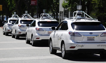a row of Google self-driving Lexus cars at a Google event outside the Computer History Museum in Mountain View, California.