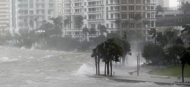 Waves crash over a seawall at the mouth of the Miami River from Biscayne Bay, Fla., as Hurricane Irma passes by, Sunday, Sept. 10, 2017, in Miami.