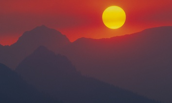 Sunset over Glacier National Park, in Montana, with forest fire haze.