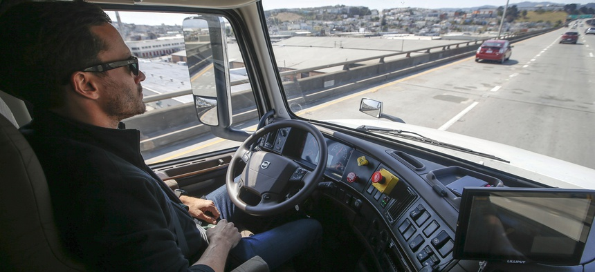 Matt Grigsby, senior program engineer at Otto, takes his hands off the steering wheel of the self-driving, big-rig truck during a demonstration on the highway, on Aug. 18, 2016, in San Francisco.