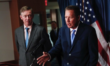Ohio Gov. John Kasich, right, joined by Colorado Gov. John Hickenlooper, speaks during a news conference at the National Press Club in Washington D.C.