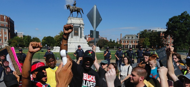 Black Lives Matters protesters led a chant in front of the statue of Confederate General Robert E. Lee on Monument Avenue in Richmond, Virginia on Saturday.
