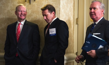 The U.S. Conference of Mayors' former president, Oklahoma City Mayor Mick Cornett, left, and Gresham, Oregon Mayor Shane Bemis, center, wait for a news conference to begin in Washington, D.C. in Jan. 2016.