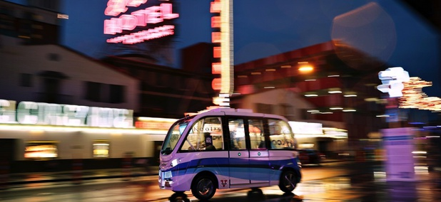 The Navya Arma autonomous vehicle drives down a street in Las Vegas.