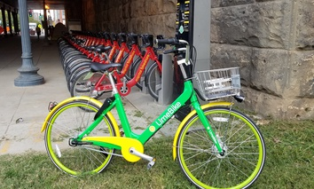 A dockless LimeBike stands next to a Capital Bikeshare docking station near Union Station in Washington, D.C.