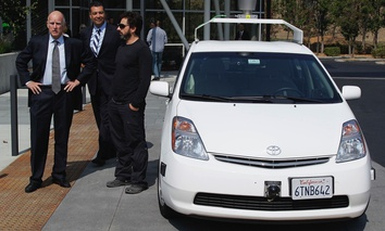 California Gov. Edmund G Brown Jr., state Senator Alex Padilla and Google co-founder Sergey Brin stand by a driverless car they arrived in at Google headquarters in Mountain View on Sept. 25.