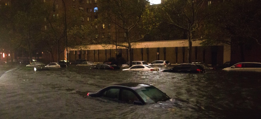 Flood waters from Superstorm Sandy surround a vehicle near the Consolidated Edison power plant in New York in October 2012.