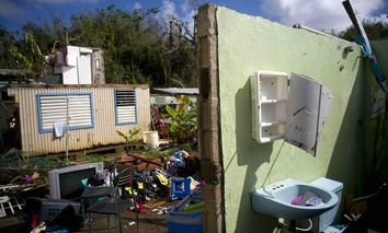 A home in Toa Baja, Puerto Rico lays in ruins after Hurricane Maria.