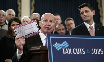 "House Ways and Means Committee Chairman Kevin Brady, R-Texas, joined by Speaker of the House Paul Ryan, R-Wis., right, holds a proposed ""postcard tax filing form"" as they unveil the GOP's far-reaching tax overhaul, on Thursday, Nov. 2, 2017."