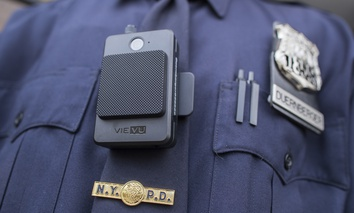 A police officer wears a newly issued body camera outside the 34th precinct, Thursday, April 27, 2017, in New York.