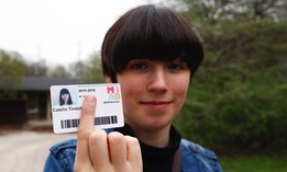 Catelin Tindall holds her expired student ID from the Milwaukee Institute of Art and Design at Cannon Park in front of the building where she tried to vote during the November 2016 presidential election.