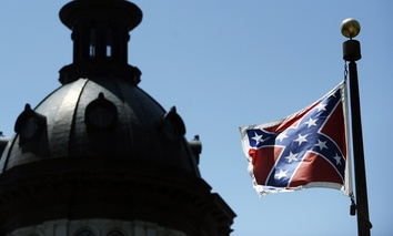 The Confederate flag flies on the grounds of the South Carolina Capitol building in Columbia.