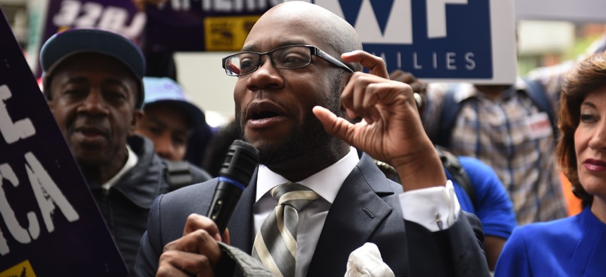 Rev. Willie Francois and other labor activists gathered May 20 along Varick Street in New York City to urge the municipal Wage Board to seek a $15 per hour minimum wage.