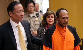 In this July 7, 2015 file photo, Juan Francisco Lopez-Sanchez, right, is lead into the courtroom by San Francisco Public Defender Jeff Adachi, left, and Assistant District Attorney Diana Garciaor, center, for his arraignment.